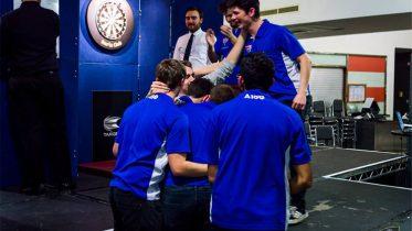 Bullseye: The Darts society celebrate as Dan Adams scoops top prize. Image: Daniel Knight