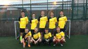 Berocca Juniors team lineup in front of goal