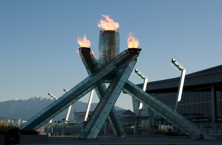 Olympic Flame at the Vancouver 2010 Winter Olympics, with mountains in the background